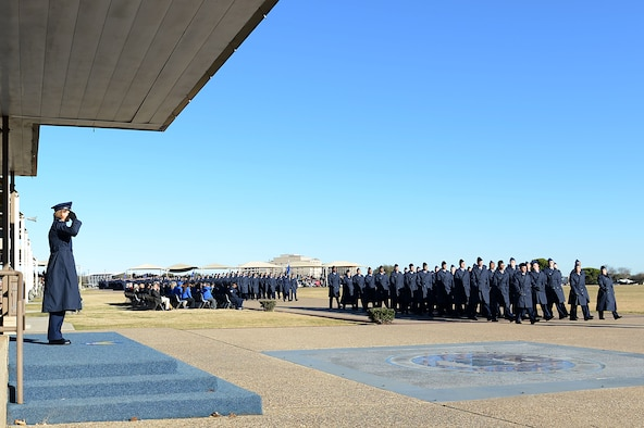 Col. Rebecca Sonkiss, 62nd Airlift Wing commander, returns a salute from graduating Airmen and their Military Training Instructors during a graduation parade, January 12, 2018, at Joint Base San Antonio, Texas.