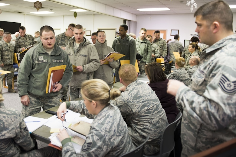 Airmen assigned to various career fields at the 167th Airlift Wing, West Virginia Air National Guard, process through a mobility line, Jan. 6, to complete administrative tasks prior to their departure overseas.