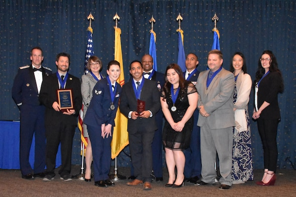 The Air Force Nuclear Weapons Center recognized its annual award winners at a ceremony Jan. 25 at the Mountain View Club, Kirtland AFB, New Mexico.  Pictured left to right: Maj. Gen. Shaun Morris, AFNWC commander, David Bax, Leslie Remy, Senior Airman Darian Bolles, Ray Campos, Master Sgt. Jerry Chandler, Jessica Keomatu, Tech. Sgt. Kamuela Kalilikane, Wesley Treadway, Stephanie Mma and Megan Wheeler.