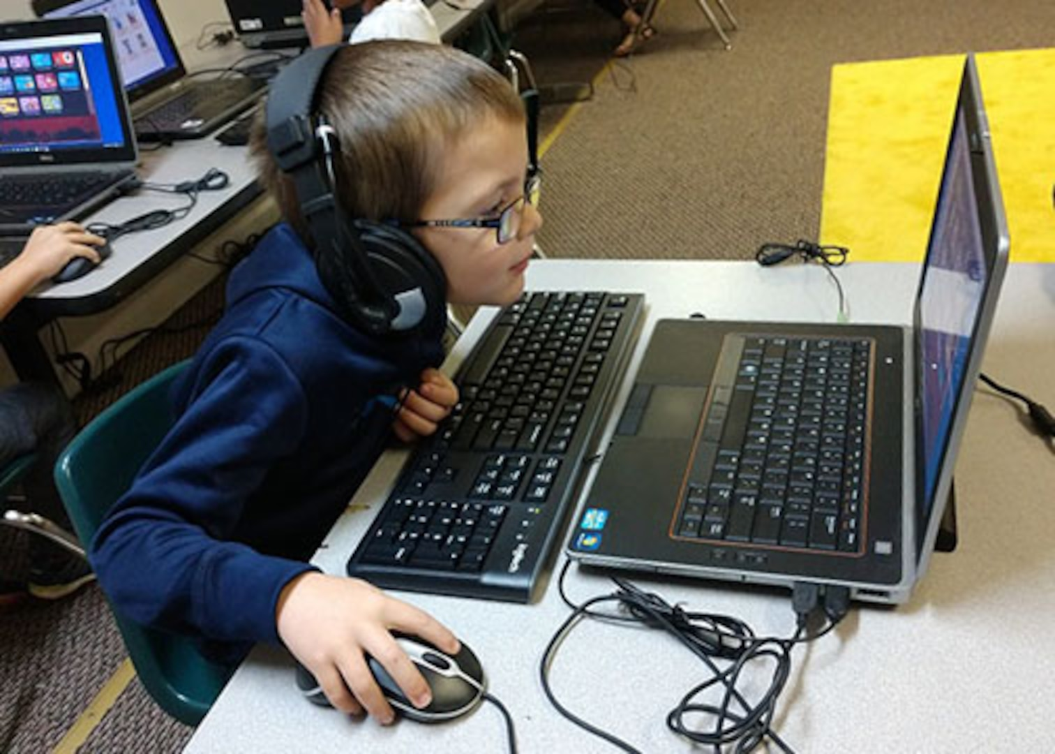 A student at San Antonio, Texas' Royal Point Academy learns on a former computer that came through DLA Disposition Services at San Antonio and DoD's Computers for Learning program. Photo provided by Royal Point Academy
