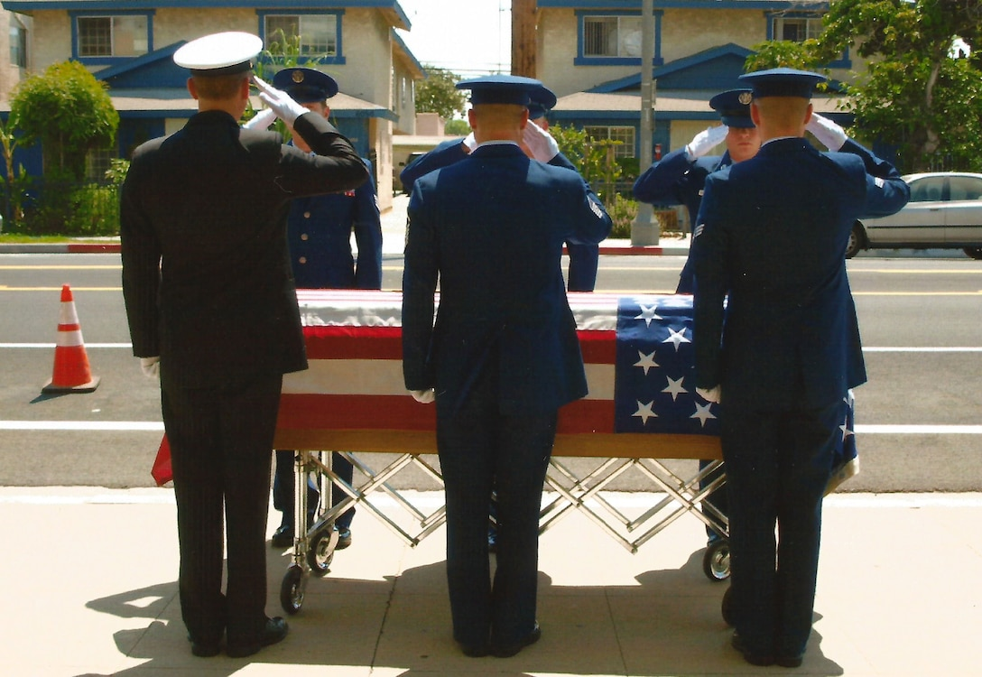 Roy Dean Baumgartner, a United States Navy Veteran (1945 - 1959), receives a final salute from his six grandsons currently serving in the military at his funeral in June, 2017.