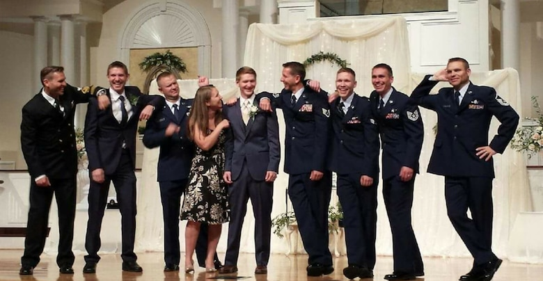 All nine Baumgartner siblings pose for a photo at their youngest brother, Stephen's, wedding.
