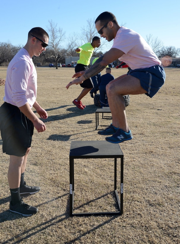 From left, Senior Airman Seth Mannos, 72nd Operations Support Squadron, and Senior Airman Caleb Snovel, 138th Maintenance Squadron, alternate jumping onto a stand during PT at Airman Leadership School Jan. 23.