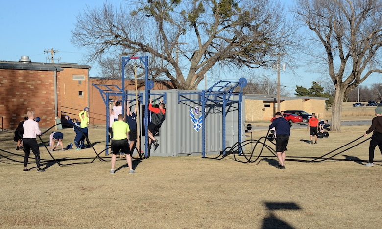 The Combat Cube is the newest addition to the Tinker Airman Leadership's School's PT curriculum. The Cube houses weights, battle ropes, resistance bands, and kettle bells, for example, to use for various exercises and the outside features pull-up stations and a rope climb, providing extensive combinations of PT possibilities to benefit the Airmen for years to come.