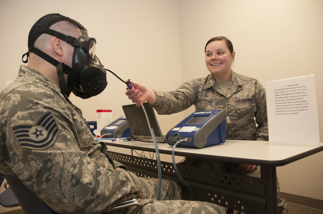 Staff Sgt. Audrey Carlstrom a bio-environmental engineering technician with the 127th Medical Group, practices administering a fit test on Tech. Sgt. Brandon Reif, a fellow bio-environmental engineering technician, while waiting for the next customer on February 3, 2018.  Quantitative fit tests are conducted on gas masks to ensure the mask properly fits all servicemembers assigned to wear them.