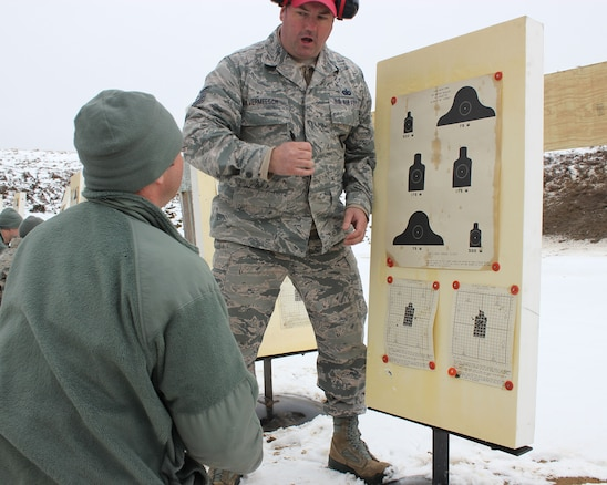 Tech. Sgt. Brad Vermeesch, a combat arms training instructor, reviews the marksmanship of a fellow Airman during training at Selfridge Air National Guard Base, Mich., Feb. 4, 2018. The Citizen-Airmen of the 127th Wing spent the February regularly scheduled drill focused on expeditionary skills training.