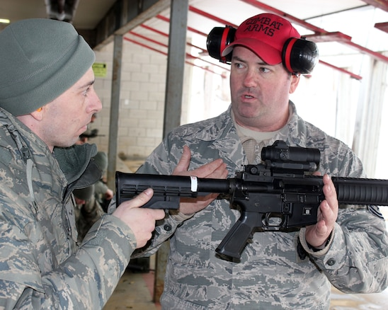 Airman 1st Class Michael Gardner is instructed in firearms marksmanship by Tech. Sgt. Brad Vermeesch at Selfridge Air Nationa Guard Base, Mich., Feb. 4, 2018. The Citizen-Airmen of the 127th Wing spent the February regularly scheduled drill focused on expeditionary skills training.
