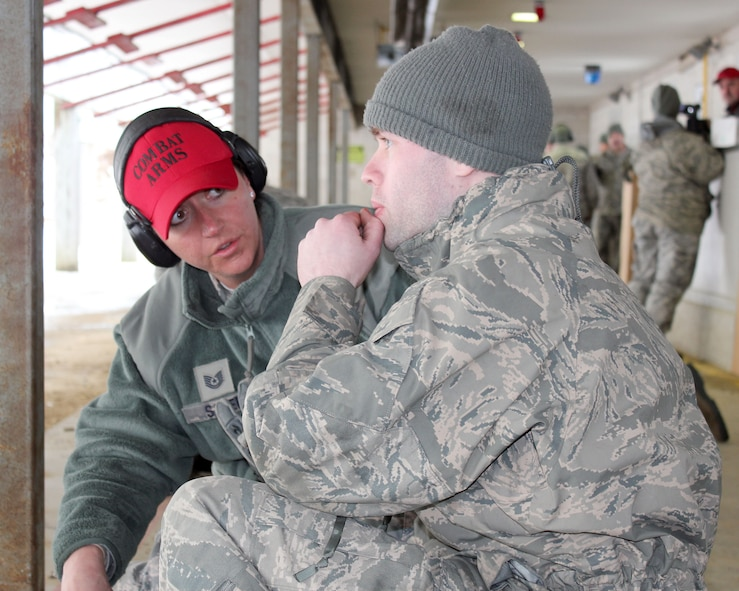 Tech. Sgt. Jennifer Sauer works with Senior Airman Scott Lange at the rifle marksmanship range at Selfridge Air National Guard Base, Mich., Feb. 4, 2018. The Citizen-Airmen of the 127th Wing spent the February regularly scheduled drill focused on expeditionary skills training.
