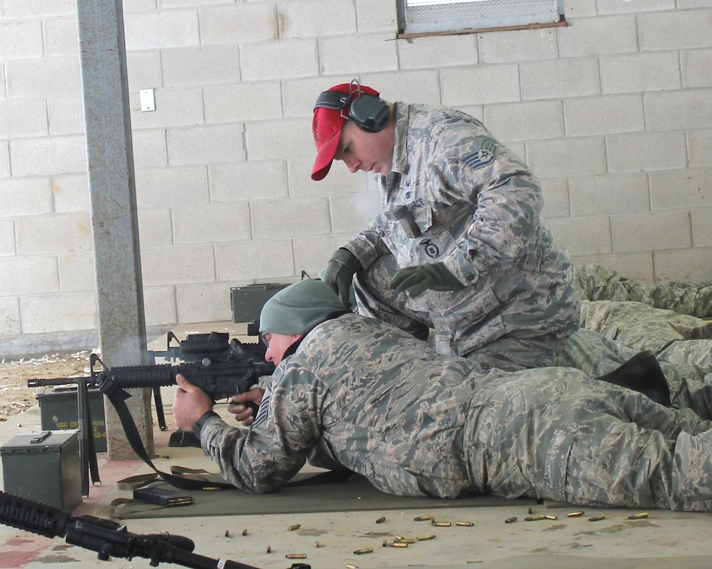 Staff Sgt. Jeff DeClercq works with a fellow Airman at the rifle marksmanship range at Selfridge Air National Guard Base, Mich., Feb. 4, 2018. The Citizen-Airmen of the 127th Wing spent the February regularly scheduled drill focused on expeditionary skills training.
