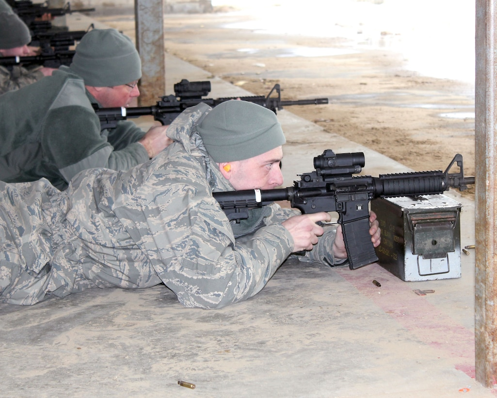 Senior Airman Scott Lange fires an M-4 rifle on the marksmanship range at Selfridge Air National Guard Base, Mich., Feb. 4, 2018. The Citizen-Airmen of the 127th Wing spent the February regularly scheduled drill focused on expeditionary skills training.