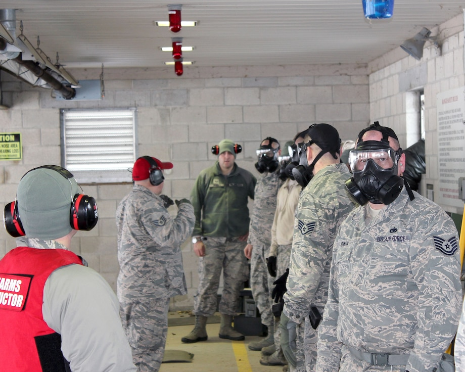 Michigan Air National Guard Airmen prepare to engage in rifle marksmanship training while wearing gas masks at Selfridge Air National Guard Base, Mich., Feb. 4, 2018. The Citizen-Airmen of the 127th Wing spent the February regularly scheduled drill focused on expeditionary skills training.