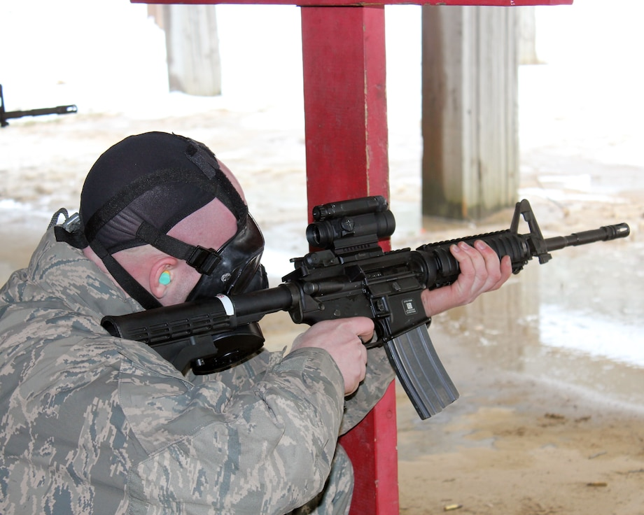 Senior Airman Scott Lange fires an M-4 rifle during marksmanship training, while wearing a gas mask, at Selfridge Air National Guard Base, Mich., Feb. 4, 2018. The Citizen-Airmen of the 127th Wing spent the February regularly scheduled drill focused on expeditionary skills training.