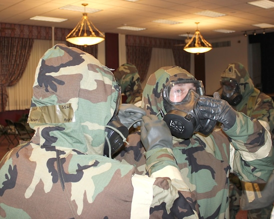 Michigan Citizen-Airmen don protective chemical gear during a readiness training exercise at Selfridge Air National Guard Base, Feb. 5, 2018. Airmen of the 127th Wing spent the February 2018 drill period reviewing basic warfighting and readiness skills.