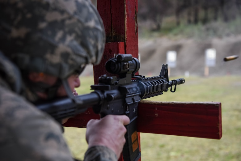 Tech. Sgt. Christopher Groessler, 62nd Maintenance Squadron munitions technician, fires an M-4 carbine during the 627th Security Forces Squadron's Combat Arms Training and Maintenance class at Joint Base Lewis-McChord, Wash., Jan. 31, 2018.