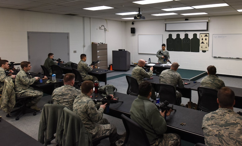 Staff Sgt. Dan Antonio Deldingco, 627th Security Forces Squadron Combat Arms Training and Maintenance instructor, teaches a class on how to properly handle and use an M-4 carbine at Joint Base Lewis-McChord, Wash., Jan. 31, 2018.