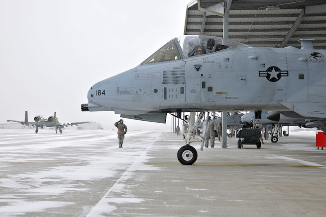 Members of the 127th Aircraft Maintenance Squadron, perform flight operations on the A-10 Thunderbolt II at Selfridge Air National Guard Base, Mich., Feb. 3, 2018. The maintenance and flight crews for the A-10 Thunderbolt II, perform their duties year round, regardless of weather conditions.