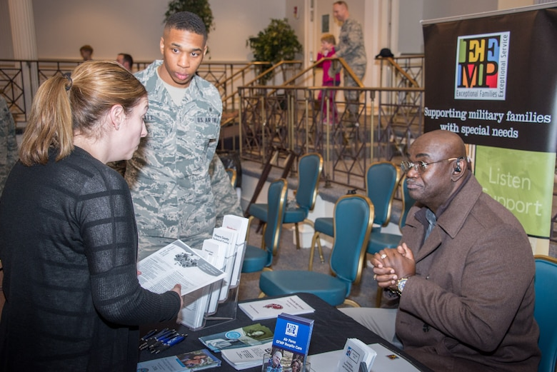 Randy Stokes, the Maxwell Air Force Base school liaison officer, talks with a guest at the Exceptional Family Member Program Town Hall and Information Fair, Jan. 31, 2018, at the Maxwell Club. The event drew more than 100 people and 25 on- and off-base EFMP service providers. The town hall was held to share information with EFMP families, friends and coworkers about available services and about the program itself. (U.S. Air Force photo by William Birchfield)