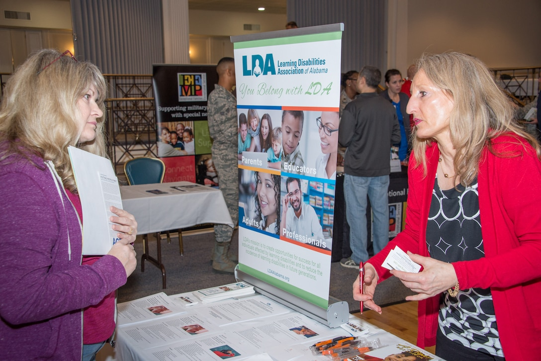 Tamara Massey with the Learning Disabilities Association of Alabama organization talks with a guest at the Exceptional Family Member Program Town Hall and Information Fair, Jan. 31, 2018, at the Maxwell Club. The event drew more than 100 people and 25 on- and off-base EFMP service providers. The town hall was held to share information with EFMP families, friends and coworkers about available services and about the program itself. (U.S. Air Force photo by William Birchfield)