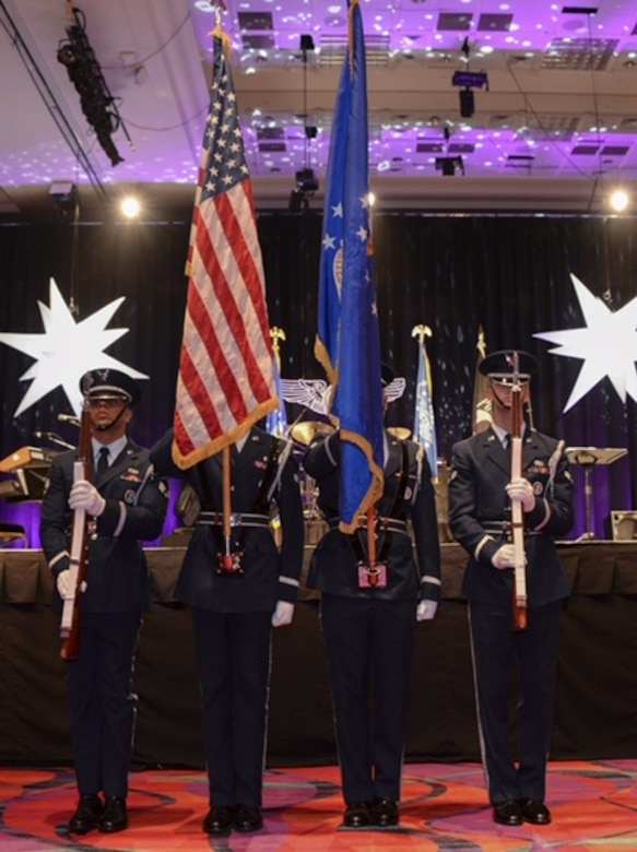 The Honor Guard from Travis Air Force Base, Calif., present the colors at the Air Force Sergeants Association International Convention in Reno,Nevada. This signified the beginning of the Air Force Honors Banquet, which was the final event for the Professional Airmen's Conference. (U.S. Air Force photo by Senior Airman Amber Carter)