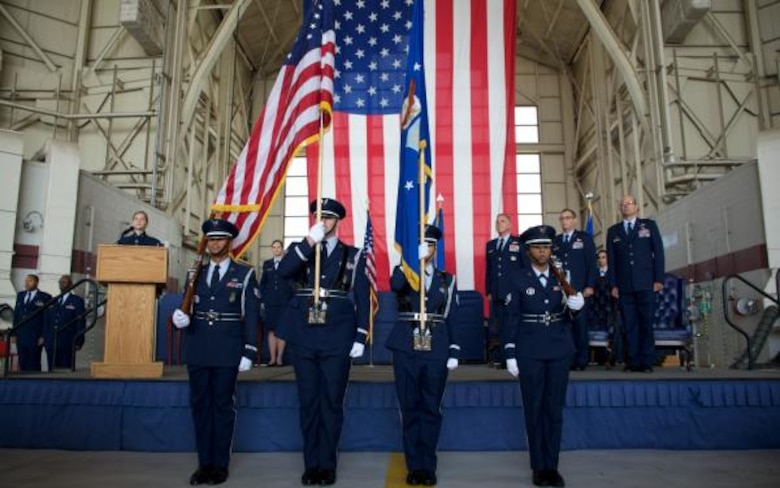 The Travis Honor Guard stands in formation before the change of command ceremony Aug. 8, 2015 at Travis Air Force Base, Calif. In the ceremony, Col. Raymond A. Kozak assumed command of the 349th Air Mobility Wing from Col. Matthew J. Burger. Kozak leads more than 3,100 combat-ready Citizen Airmen, flying and maintaining the C-17 Globemaster III, C-5 Galaxy and KC-10 Extender mobility aircraft. Col. Matthew J. Burger, outgoing 349th AMW commander, assumed duties in the Pentagon as the Programs and Requirements Division chief, Air Force Reserve Command. (U.S. Air Force photo/Senior Airman Madelyn Brown)