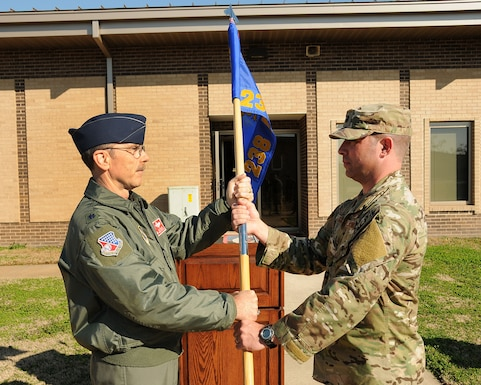 U.S. Air Force Lt. Col. Kelly Miller, commander of the 186th Operations Group, passes the guidon in a change of command ceremony to Lt. Col. Ross Goodin at Key Field Air National Guard Base, Meridian, Miss., Feb. 4, 2018.