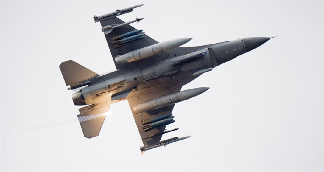 An F-16 Fighting Falcon releases a flare over Grand Bay Bombing and Gunnery Range at Moody Air Force Base, Ga., Mar. 4, 2016. Master Sgt. Terri Adams, 23d Civil Engineer Squadron emergency management section chief, won the Air Combat Command's level of the Air Force Spark Tank competition. Her submission was designed to simplify the way hydrazine spills are cleaned up at Air Force bases that house F-16 Fighting Falcon or Minuteman III missiles worldwide, saving bases upwards of $10,000 for every 6.8 gallons of hydrazine. (U.S. Air Force photo by Staff Sgt. Brian J. Valencia)