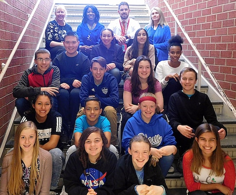 IMAGE: FREDERICKSBURG, Va. (Jan. 30, 2018) – The 15 students recognized for placing first, second, third, and honorable mention at the 2018 Freedom Middle School Science Fair are pictured with school officials. They were among 108 students who presented 88 science, technology, engineering, and mathematics projects in three categories: earth and space, life science and biology, and physical science. The students briefed their projects to 15 judges – including 12 scientists and engineers from Naval Surface Warfare Center Dahlgren Division – who interviewed and mentored the students while evaluating their projects. Students pictured left to right on the first row (bottom) are: Samantha Quillen, Emilee Imler, Kaitlyn Bestick, and Hannah Lowery. Second row: Rachel Margelos, Caleb Caison, and Regan Bestick. Third row: Gavin White, Calvin Campbell, Areanna Jess, and Garrett Peck. Fourth row: Daniel Fordham, Hailey Gibson, Phoebe Awan, and M'Laya Ainsworth. Freedom Middle School officials pictured in the top row: Advanced Science Teacher Linda Lapp, Vice Principal Dwan Barnes Gaines, Principal Dr. Eric Wright, and Physical Science Teacher Mendy Owen.