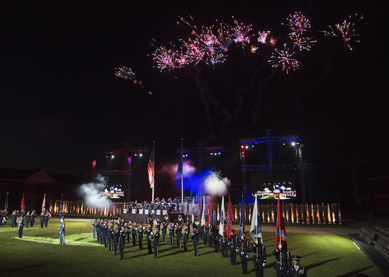 Members with the U.S. Air Force Honor Guard and Band perform during the U.S. Air Force Tattoo at Joint Base Anacostia-Bolling, Washington, D.C., Sept. 13, 2017. Service members from across the National Capital Region attended the tattoo in commemoration of the Air Force's 70th anniversary. (U.S. Air Force photo by Airman 1st Class Valentina Lopez)