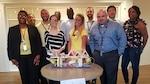 Barbara Runnels, far left, Contracts group lead at Defense Contract Management Agency Manassas in Virginia, congratulates the Bumblebees, a group of employees who were recognized for their bridge project and teambuilding skills. Runnels, who supervises approximately 50 employees, hosts various events during the year to help employees bond with one another and to use their analytical and problem-solving skills. Front row, left to right: Runnels, Ashley Bishop, Melissa Cooper, Jon-Paul Grizzle and Arica Rasheed. Back row, left to right: Leasia Henderson, Donovan Pepley, Derrick Reynolds, Sileye Diop, Christopher Lambert and Mark Shinn. (DCMA photo courtesy of Barbara Runnels)