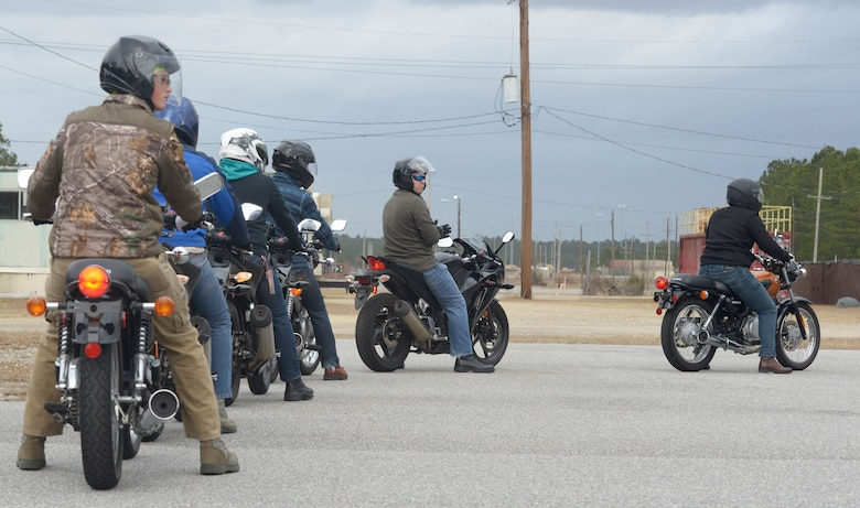 Students in the Basic Motorcycle Rider's Course line up to run through an obstacle course Feb. 4 at Joint Base Charleston Naval Weapons Station.