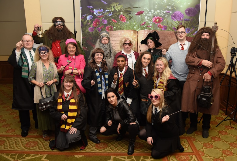 Members of the 81st Dental Squadron pose for a photo as they portray the cast of Harry Potter during the 30th Annual Krewe of Medics Mardi Gras Ball at the Bay Breeze Event Center Feb. 3, 2018, on Keesler Air Force Base, Mississippi. The Krewe of Medics hosts a yearly ball to give Keesler Medical Center personnel a taste of the Gulf Coast and an opportunity to experience a traditional Mardi Gras. The theme for this year's ball was Read It-Be It. The 81st DS won first place in the costume contest. (U.S. Air Force photo by Kemberly Groue)