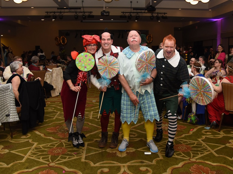 Members of the 81st Medical Operations Squadron portray munchkins from The Wizard of Oz during the 30th Annual Krewe of Medics Mardi Gras Ball at the Bay Breeze Event Center Feb. 3, 2018, on Keesler Air Force Base, Mississippi. The Krewe of Medics hosts a yearly ball to give Keesler Medical Center personnel a taste of the Gulf Coast and an opportunity to experience a traditional Mardi Gras. The theme for this year's ball was Read It-Be It. (U.S. Air Force photo by Kemberly Groue)