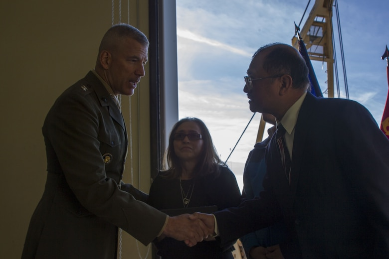 Major General William F. Mullen III, Commanding General, Marine Air Ground Task Force Training Command, Marine Corps Air Ground Combat Center, shakes hands with Staff Sgt. Enrico Antonio Rojo's family at a memorial aboard the Marine Corps Air Ground Combat Center, Twentynine Palms, Calif., Jan. 21, 2018. Staff Sgt. Rojo was awarded a Navy and Marine Corps Medal for attempting to help the victim of a car accident on December 16, 2016. (U.S. Marine Corps photo by Pfc. Rachel K. Porter).