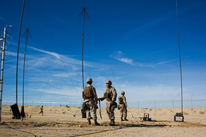 Marines with Marine Wing Communication Squadron 38 dig trenches for wires at Camp Wilson aboard the Marine Corps Air Ground Combat Center, Twentynine Palms, Calif., January 22, 2018, as a part of Integrated Training Exercise 2-18. The purpose of ITX is to create a challenging, realistic training environment that produces a combat-ready forces capable of operating as an integrated MAGTF. (Photo provided by courtesy asset)