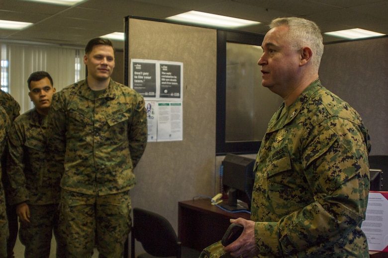 Col. Ricardo Martinez, chief of staff, Marine Air Ground Task Force Training Command, Marine Corps Air Ground Combat Center, speaks with Marines of the Fleet Assistance Program at the opening of the Tax Center aboard MCAGCC, Jan. 29, 2018. The Tax Center offers free assistance to Marines during Tax season. (U.S. Marine Corps photo by Pfc. Rachel K. Porter)