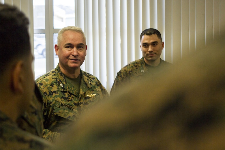Col. Ricardo Martinez, chief of staff, Marine Air Ground Task Force Training Command, Marine Corps Air Ground Combat Center, speaks to Marines with the Fleet Assistance Program at the opening of the Tax Center aboard MCAGCC, alongside Capt. Adam LoCascio, officer in charge of the Tax Center, Legal Services Support Team, Headquarters Battalion, Jan. 29, 2018. The Tax Center offers free assistance to Marines during Tax season. (U.S. Marine Corps photo by Pfc. Rachel K. Porter)