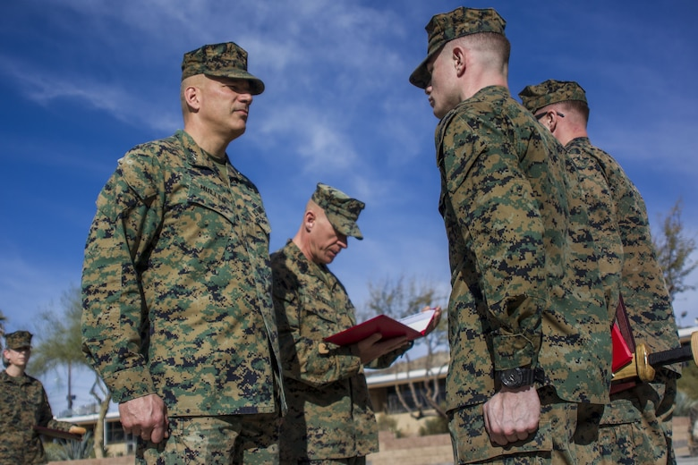 Major General William F. Mullen III, base commanding general, Marine Air Ground Task Force Training Command, Marine Corps Air Ground Combat Center presents a Marine with an award in recognition of his exemplary service aboard MCAGCC, Jan. 16, 2018. The Marines were being awarded the Navy and Marine Corps Achievement Medal for above-and-beyond service both in and out of uniform. (U.S. Marine Corps photo by Pfc. Rachel K. Porter)