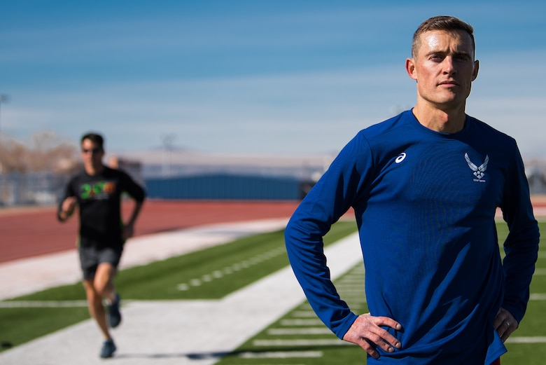 Capt. Kristopher Houghton, 377th Air Base Wing assistant staff judge advocate, poses during his training for a Conseil International du Sport Militaire (CISM) qualifying race at Milne Stadium in Albuquerque, N.M., Feb. 1, 2018. Houghton competed in the 2017 Marine Corps marathon and took fourth overall, but was the first active duty military member to finish. (U.S. Air Force photo by Staff Sgt. J.D. Strong II)