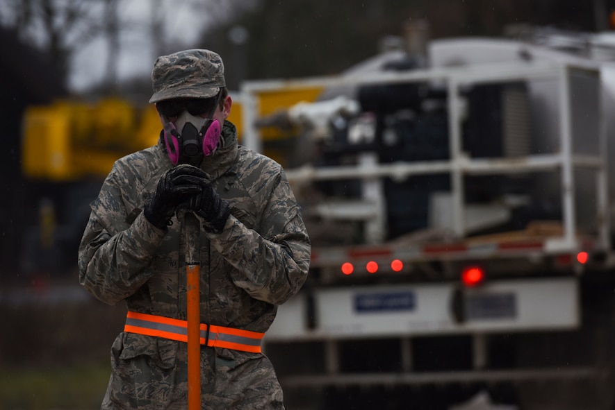 U.S. Air Force Senior Airman Jonathan Pike, 773rd Civil Engineer Squadron power production journeyman, rests during a Rapid Airfield Damage Repair training exercise on Ramstein Air Base, Germany, Jan. 25, 2018. The Airmen were tasked with filling six craters on a simulated runway. (U.S. Air Force photo by Senior Airman Devin M. Rumbaugh)