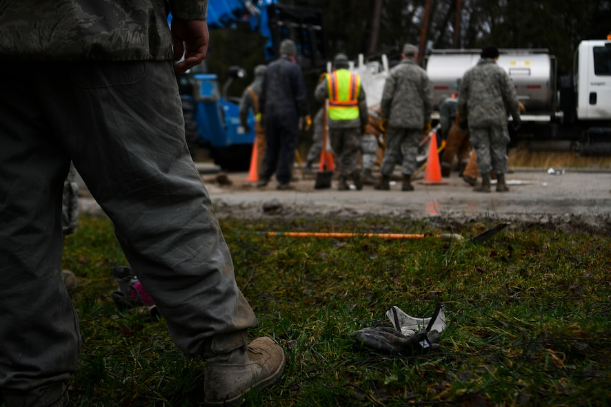 A U.S. Airman watches as his counterparts fill a hole in the runway during a Rapid Airfield Damage Repair training exercise on Ramstein Air Base, Germany, Jan. 25, 2018. Airmen would tag in and out of the exercise to rest after mixing flowable fill cement. (U.S. Air Force photo by Senior Airman Devin M. Rumbaugh)
