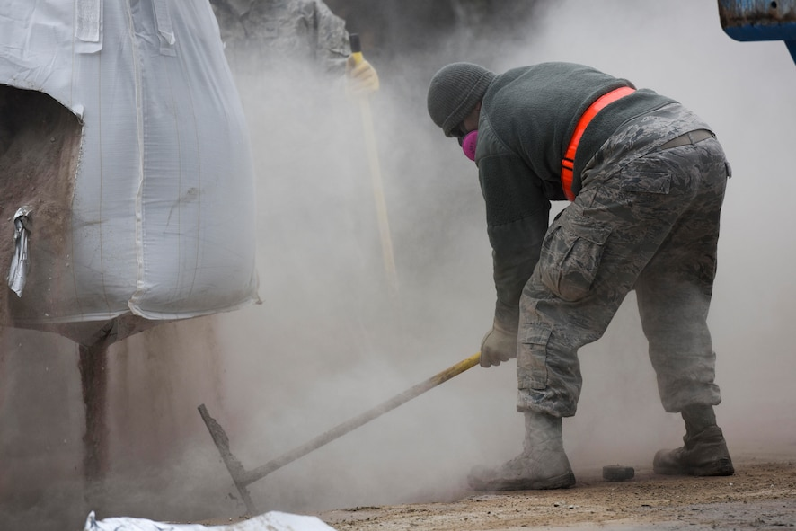 U.S. Air Force Staff Sgt. Antonio O'Campo, 773rd Civil Engineer Squadron electrical systems journeyman, mixes flowable fill concrete for a Rapid Airfield Damage Repair training exercise on Ramstein Air Base, Germany, Jan. 25, 2018. O'Campo was a part of the first class to be trained in the update RADR course. (U.S. Air Force photo by Senior Airman Devin M. Rumbaugh)