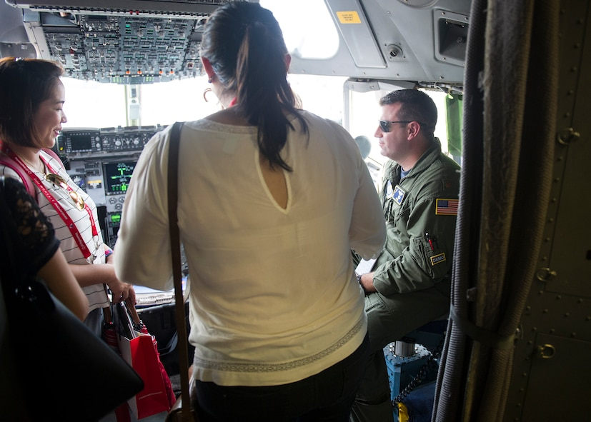 U.S. Air Force Maj. Chris McGravey, 535th Airlift Squadron gives a tour of the C-17 Globemaster III cockpit during the 2018 Singapore International Airshow, Changi Exhibition Centre, Singapore, Feb. 6, 2018