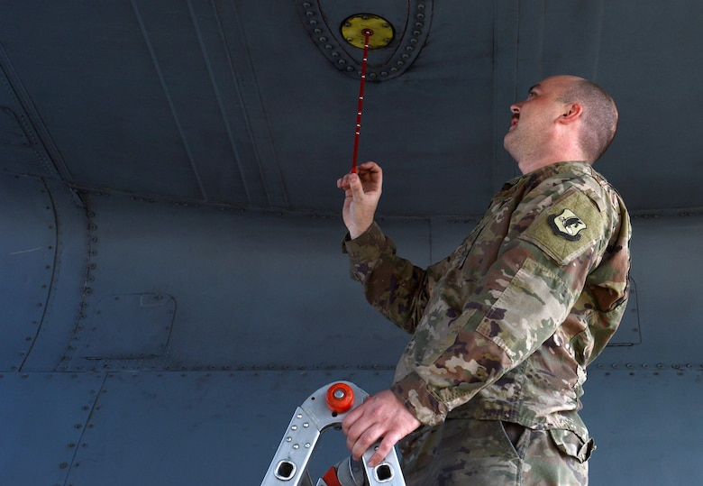 Airman 1st Class Nicholas Foydl, 455th Expeditionary Aircraft Maintenance Squadron EC-130H Compass Call crew chief, checks the oil of an EC-130H Feb. 2, 2018 at Bagram Airfield, Afghanistan.