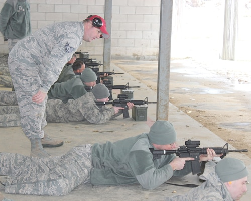 Tech. Sgt. Brad Vermeesch serves as a safety monitor while observing marksmanship training at Selfridge Air National Guard Base.