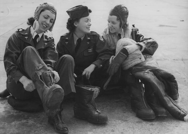U.S. Army Air Corps 2nd Lt. Geraldine L. Curtis; 2nd Lt. Geraldine F. Dishroon, and 2nd Lt. Irene McMullen, getting into their winter flying suits for a training flight in 1943. (Photo courtesy of the National Archives)