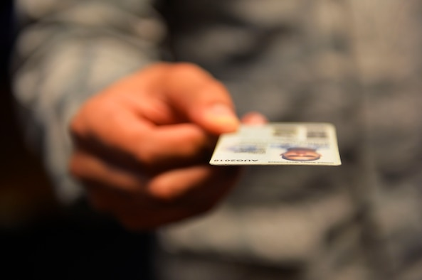 Staff Sgt. Stephen Ellis, 86th Airlift Wing public affairs broadcast journalist craftsman, holds a common access card on Ramstein Air Base, Germany, Jan. 19, 2018. The 786th Force Support Squadron instituted changes in how appointments are made for requesting new I.D. cards and renewing dependent I.D.'s. (U.S. Air Force photo by Senior Airman Joshua Magbanua)