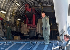 Airmen move humanitarian cargo from an Air Force transport jet in Haiti.