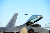 An F-22 Raptor, flown by Maj. Paul Lopez, flies by Airmen during an aerial demonstration Feb. 2, 2018, at Columbus Air Force Base, Mississippi. Lopez performed aerial demonstration at Columbus AFB in preparation for the 2018 air show season. (U.S. Air Force photo by Airman 1st Class Beaux Hebert)