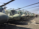 Former American UH-1H Huey helicopters provided to Thailand are received in place for disposal support from DLA Disposition Services in Thailand