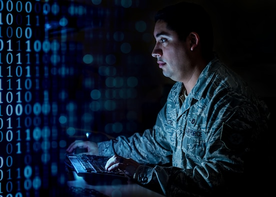 U.S. Air Force Tech. Sgt. Luis Castro, Air Combat Command, Command Center NCO in charge of command and control operations reports, works at the ACC Command Center, Joint Base Langley-Eustis, Va., Feb. 1, 2018.